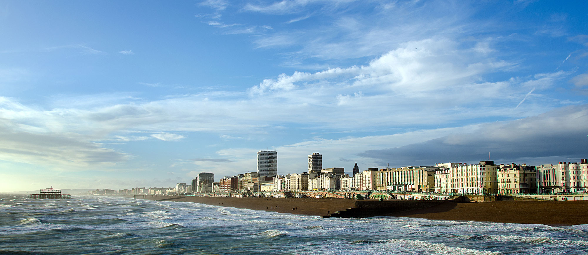 Late afternoon sunshine on Brighton Beach and the remains of the West Pier.